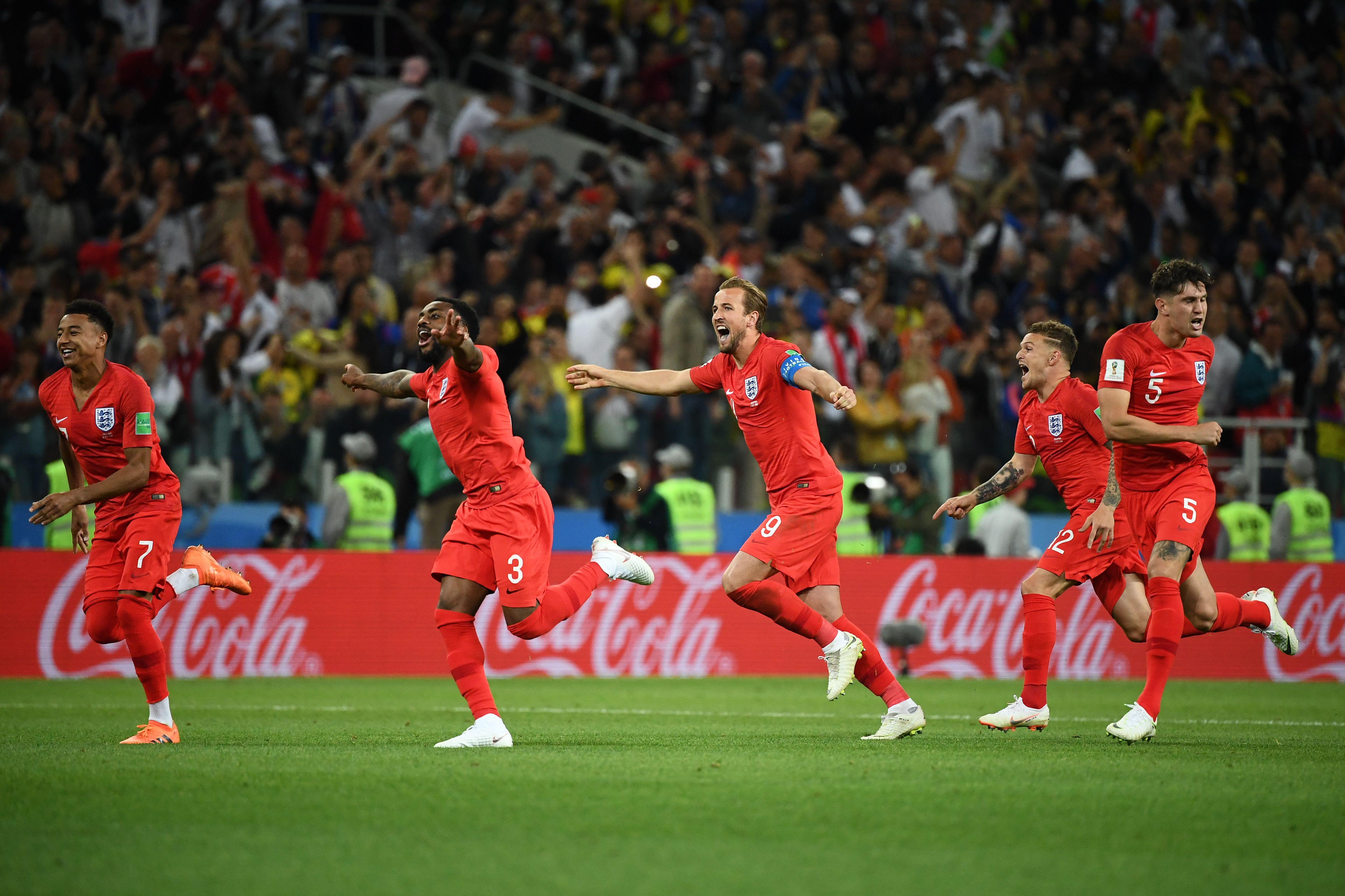 England's team players celebrate after winning against Colombia.