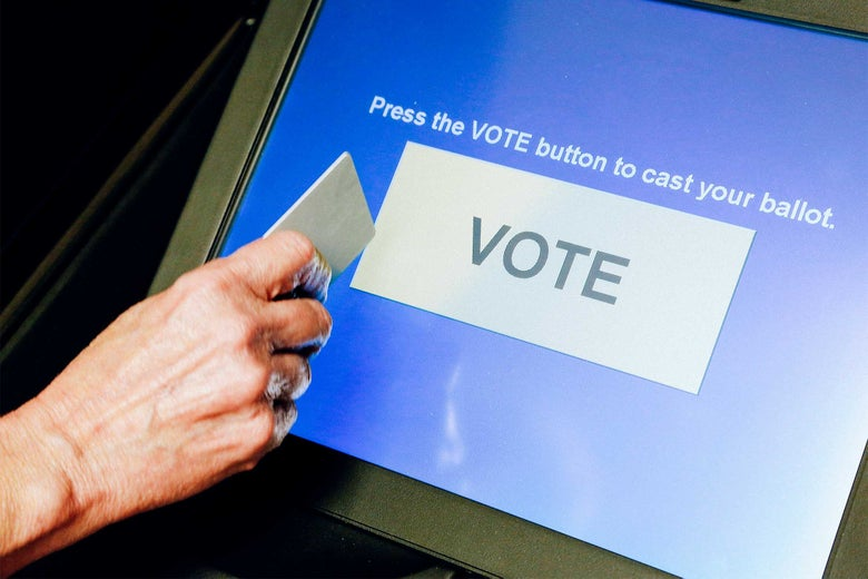 "A screen says ""Press the VOTE button to cast your ballot,"" above a large VOTE button."