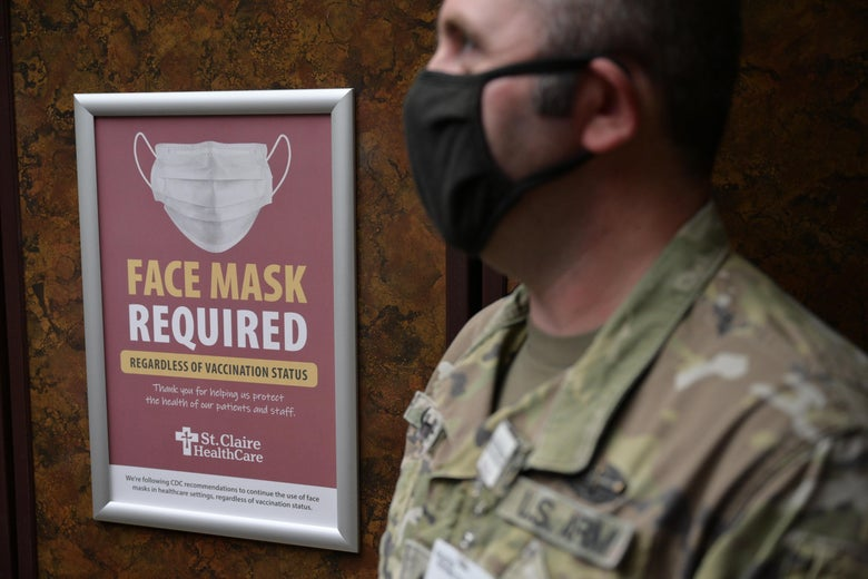 Sgt. Darrin Cushard of the Kentucky National Guard stands near a sign in an elevator denoting mask use in St. Claire Regional Medical Center on September 16, 2021 in Morehead, Kentucky.