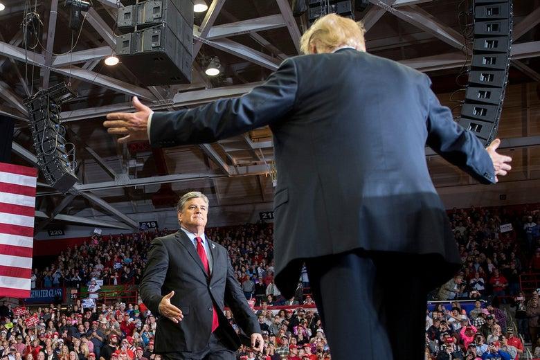 Donald Trump greets Sean Hannity at a rally.