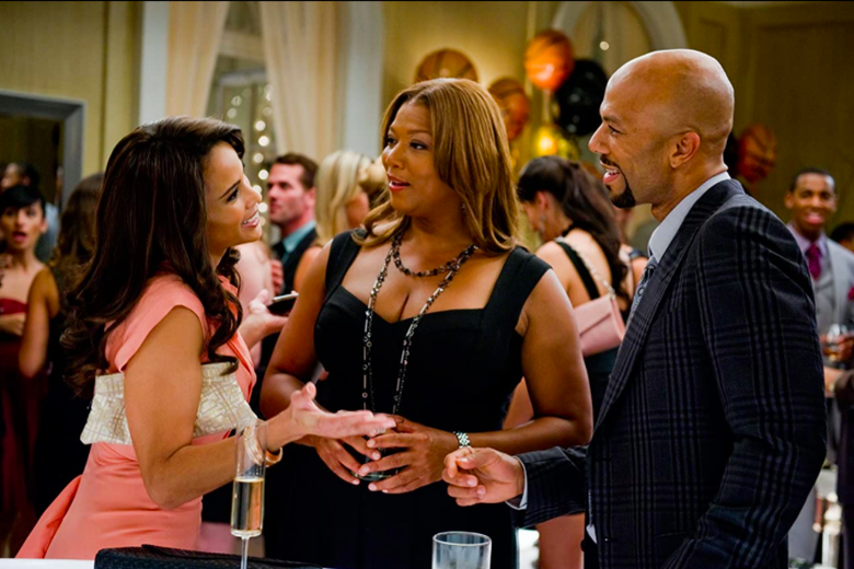 Paula Patton, Queen Latifah and Common, all wearing formal wear,  talk to each other.
