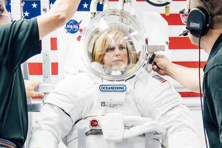 A woman in a spacesuit.