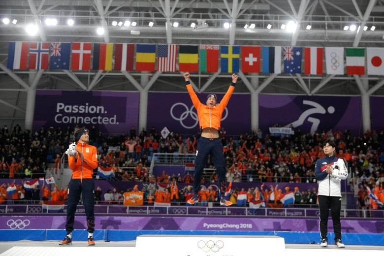 GANGNEUNG, SOUTH KOREA - FEBRUARY 13:  Gold medalist Kjeld Nuis of the Netherlands (C) celebrates with silver medalist Patrick Roest of the Netherlands (L) and bronze medalist Min Seok Kim of Korea (R) during the victory ceremony after the Men's 1500m Speed Skating on day four of the PyeongChang 2018 Winter Olympic Games at Gangneung Oval  on February 13, 2018 in Gangneung, South Korea.  (Photo by Dean Mouhtaropoulos/Getty Images)