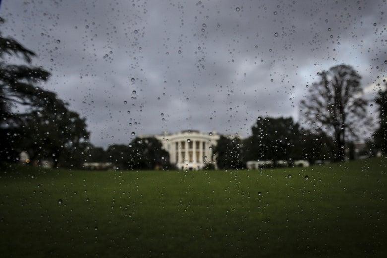 The White House seen through a raindrop-covered car window