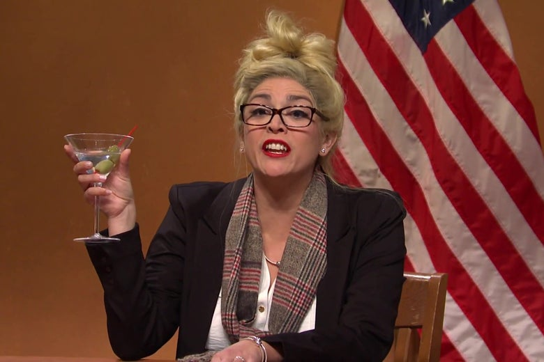 Cecily Strong, dressed as Melissa Carone, holding a martini, in a still from SNL.