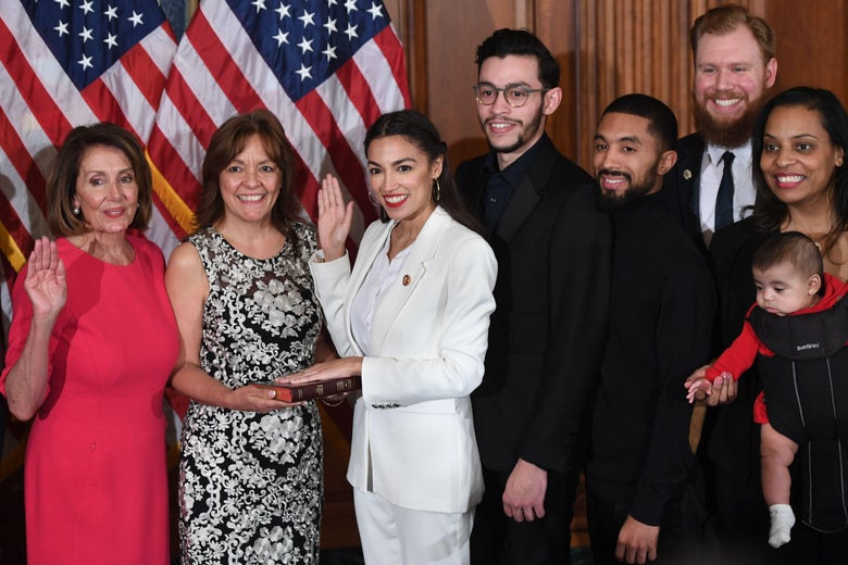 Speaker of the House Nancy Pelosi swears in Rep. Alexandria Ocasio-Cortez on Thursday.