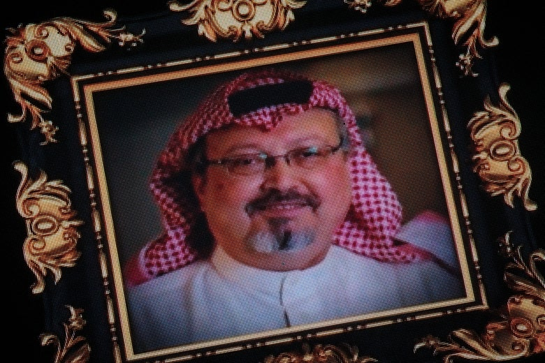 Images of murdered journalist Jamal Khashoggi are seen on a big screen during a commemorative ceremony held on November 11, 2018 in Istanbul Turkey.