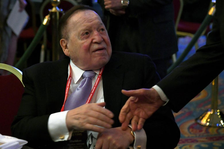 LAS VEGAS, NV - FEBRUARY 24:  Las Vegas Sands Corp. Chairman and CEO Sheldon Adelson is greeted by a guest before a speech by U.S. Vice President Mike Pence (not pictured) at the Republican Jewish Coalition's annual leadership meeting at The Venetian Las Vegas on February 24, 2017 in Las Vegas, Nevada. Pence's speech to the group of Republican Jewish leaders and donors follows his trip last week to Germany where he visited the former Dachau concentration camp and a surprise stop on Wednesday at a Jewish cemetery in Missouri that had been vandalized.  (Photo by Ethan Miller/Getty Images)