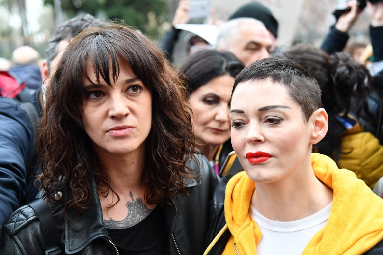 Asia Argento stands with Rose McGowan at an Italian #MeToo march in March.