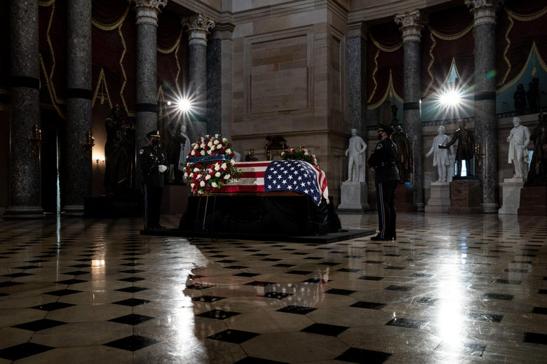 The flag-draped casket of the late Associate Justice Ruth Bader Ginsburg lies in state in Statuary Hall of the US Capitol.