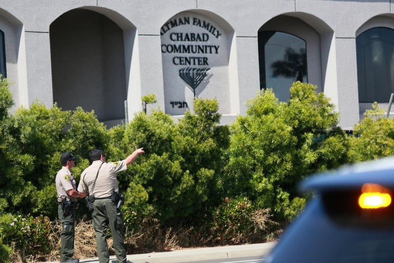 San Diego Sheriff deputies look over the Chabad of Poway Synagogue after a shooting on Saturday, April 27, 2019 in Poway, California. - A gunman opened fire at a synagogue in California, killing one person and injuring three others including the rabbi as worshippers marked the final day of Passover, officials said Saturday, April 27, 2019. The shooting in the town of Poway came exactly six months after a white supremacist shot dead 11 people at Pittsburgh's Tree of Life synagogue -- the deadliest attack on the Jewish community in the history of the United States. (Photo by SANDY HUFFAKER / AFP)        (Photo credit should read SANDY HUFFAKER/AFP/Getty Images)