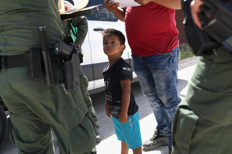 A boy and father from Honduras are taken into custody by Border Patrol agents near the U.S.-Mexico Border on June 12, 2018 near Mission, Texas.