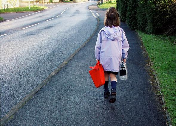 Child walking to school on her own