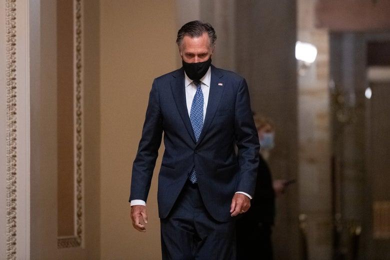 Sen. Mitt Romney (R-UT)  walks in the Capitol after President Joe Biden's address to Congress on April 28, 2021.