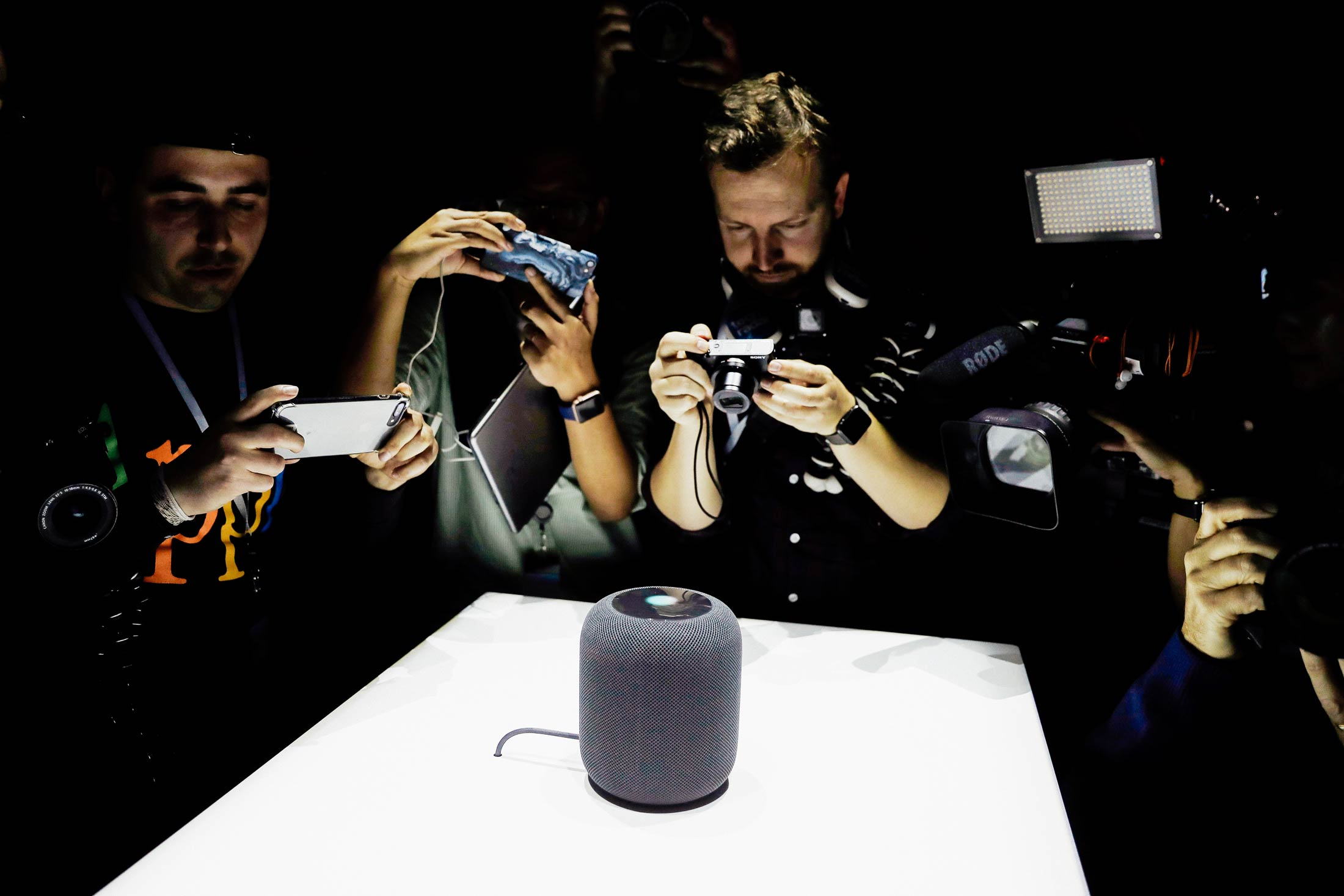 Apple HomePod surrounded by media photographers at the Apple WWDC, June 2017.