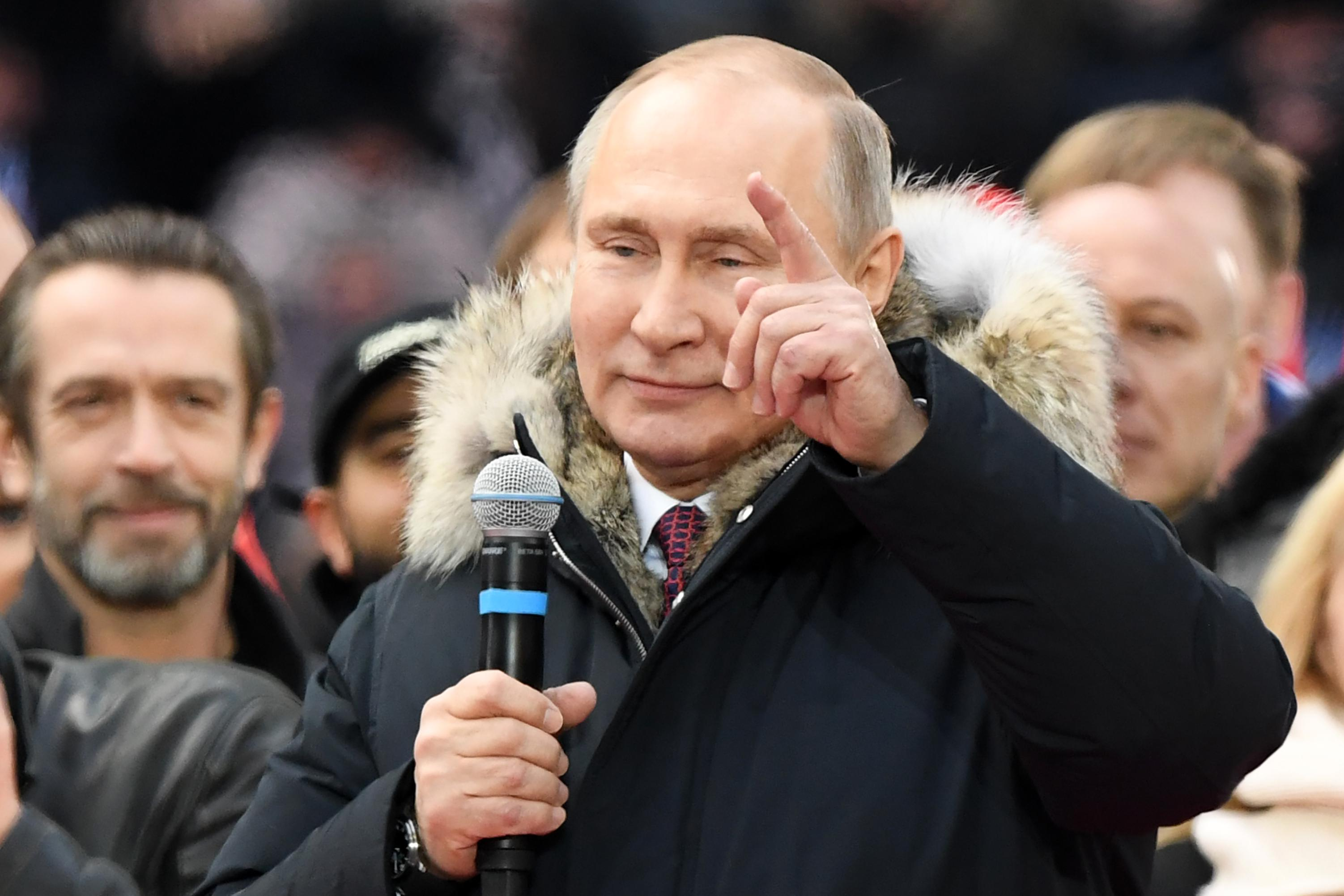 Presidential candidate, President Vladimir Putin attends a rally to support his candidature in the upcoming presidential election at the Luzhniki stadium in Moscow on March 3, 2018.         Russians will go to the polls on March 18, 2018. / AFP PHOTO / Kirill KUDRYAVTSEV        (Photo credit should read KIRILL KUDRYAVTSEV/AFP/Getty Images)