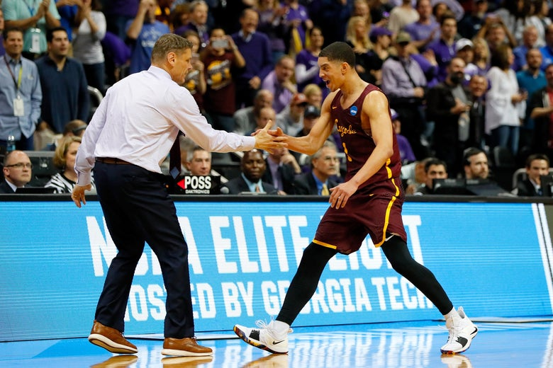 ATLANTA, GA - MARCH 24: Lucas Williamson #1 of the Loyola Ramblers celebrates with head coach Porter Moser as he exits the game late in the second half against the Kansas State Wildcats during the 2018 NCAA Men's Basketball Tournament South Regional at Philips Arena on March 24, 2018 in Atlanta, Georgia.  (Photo by Kevin C. Cox/Getty Images)