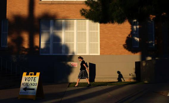 A woman walks outside Kenilworth School as she prepares to vote during the U.S. presidential election in Phoenix, Arizona November 6, 2012.