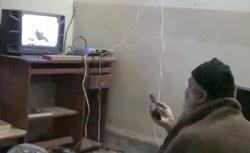 Osama Bin Laden watching himself on TV