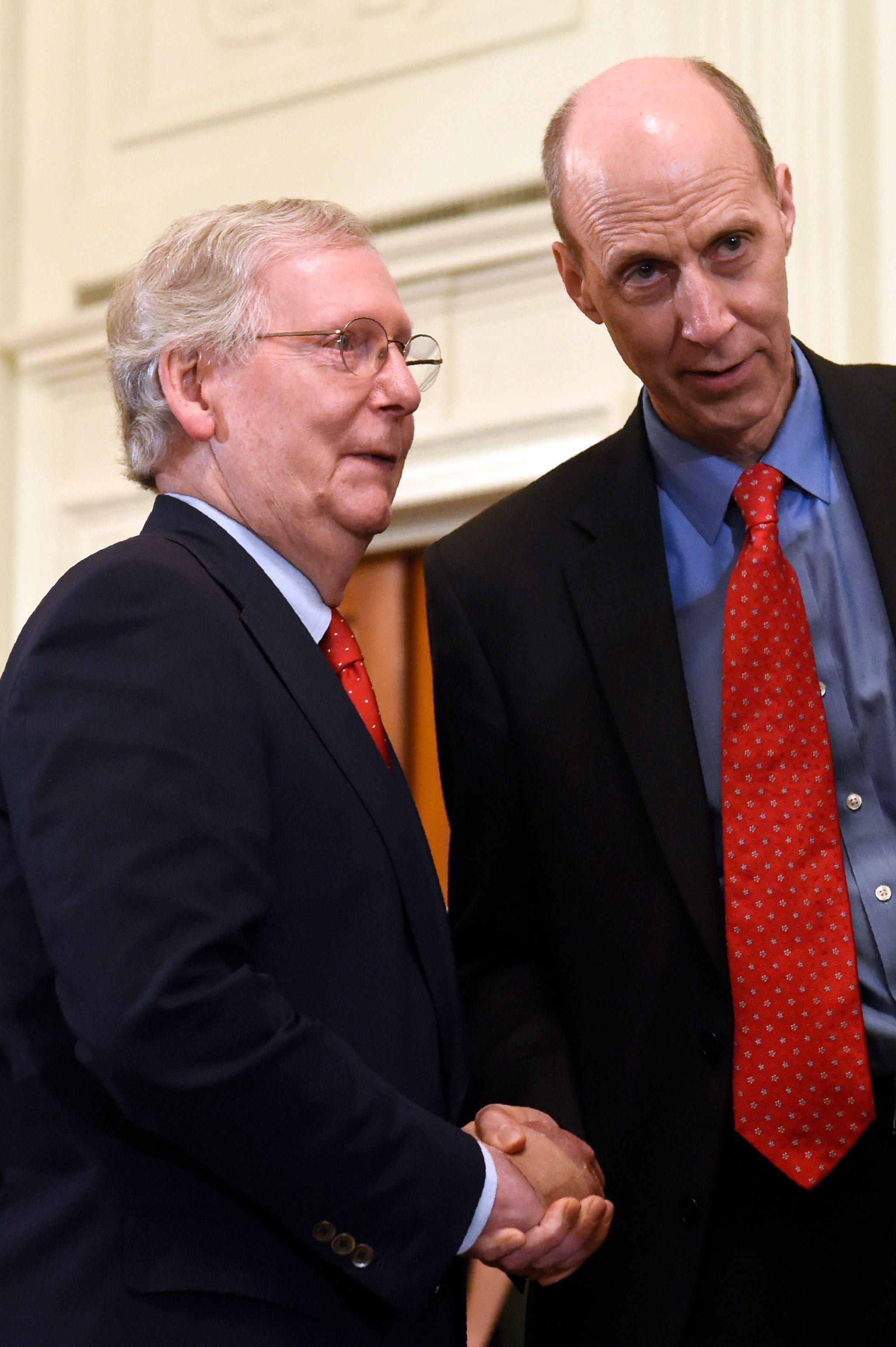 Mitch McConnell talks with Ed Whelan at the White House.