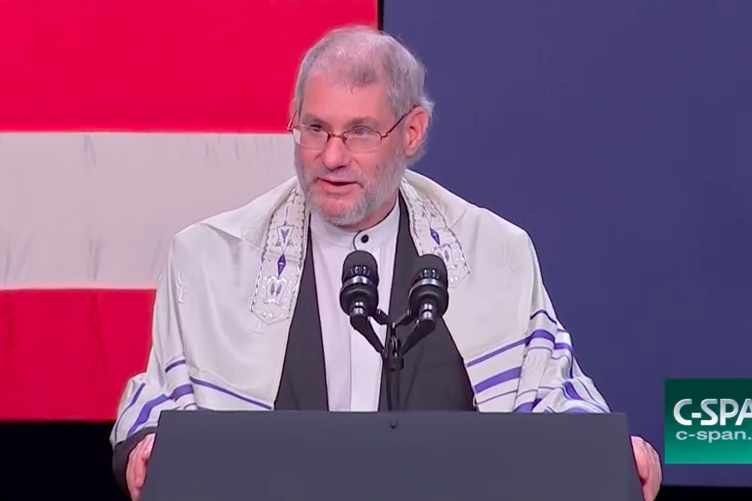 Messianic Jewish Rabbi Loren Jacobs of Synagogue Shema Yisrael offering an invocation at a campaign event for Vice President Mike Pence.