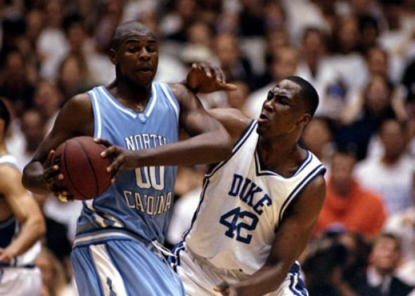Elton Brand #42 of the Duke Blue Devils tries to guard Brendan Haywood #00 of the North Carolina Tar Heels.
