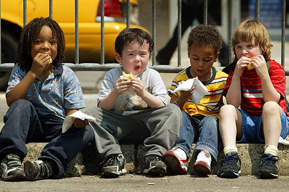 """Children eat free Oscar Meyer Wiener hot dogs in Union Square at a kickoff event announcing the Oscar Meyer """"Oh I Wish"""" contest May 11, 2004 in New York City."""