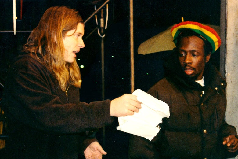 """Mark Woollen chats with Wyclef Jean on the set of """"Rumble In the Jungle."""""""