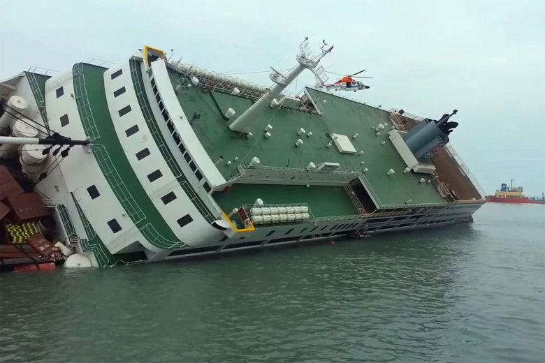 A ship flipped over on its side.