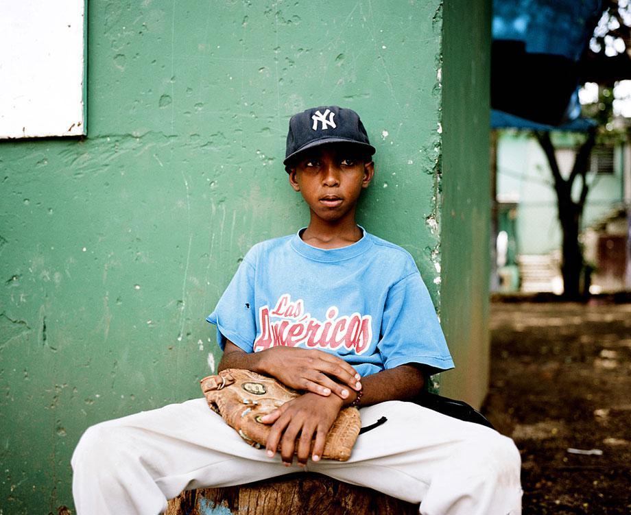 SANTO DOMINGO, DOMINICAN REPUBLIC. A portrait of a young pitcher in Santo Domingo.