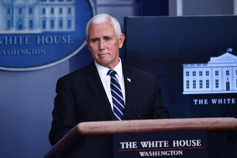 Mike Pence standing at a podium in the White House press briefing room