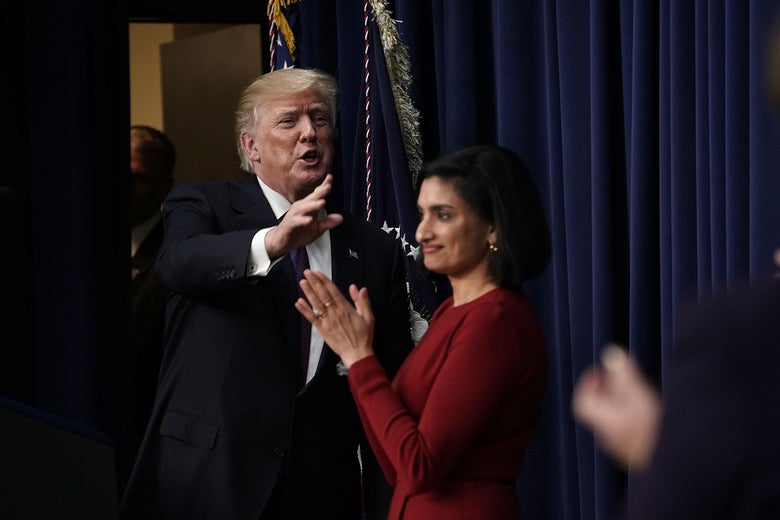 WASHINGTON, DC - JANUARY 16:  U.S. President Donald Trump (L) acknowledges the audience as Administrator of the Centers for Medicare and Medicaid Services Seema Verma (R) looks on as he stops by a Conversations with the Women of America panel at the South Court Auditorium of Eisenhower Executive Office Building January 18, 2018 in Washington, DC. The three-part panel features ÒAmerican women from various backgrounds and experiences who will speak with high-level women within the Trump Administration, about what has been accomplished to date to advance women at home, and in the workplace.Ó (Photo by Alex Wong/Getty Images)
