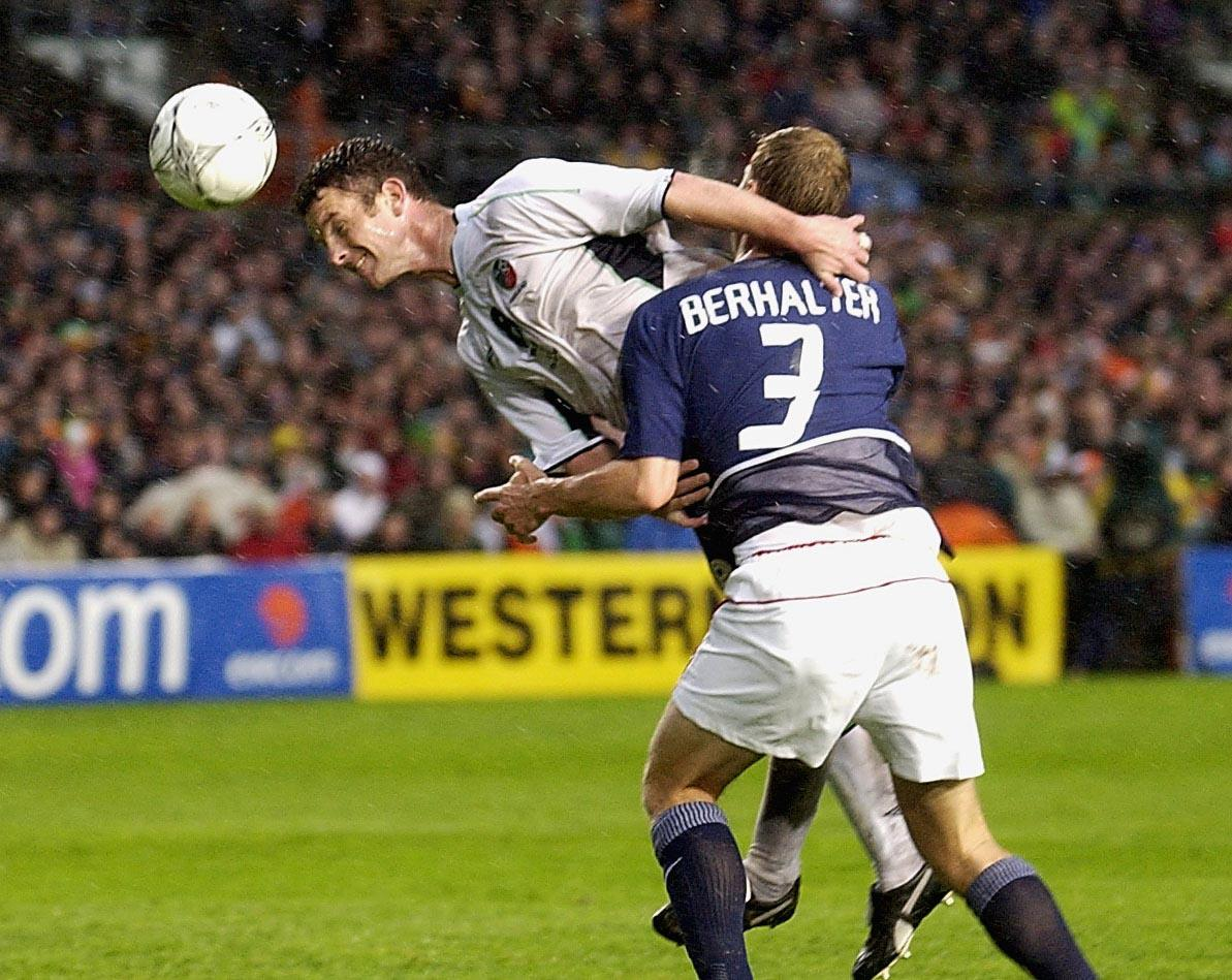 Mark Kinsella of Ireland is challenged by Gregg Berhalter of the USA.