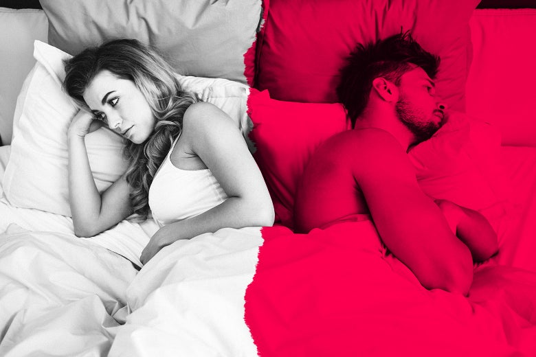 An unsettled couple in bed facing in opposite directions.