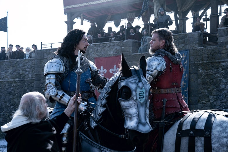 Adam Driver and Matt Damon lock eyes atop their steads, their gazes piercing their chain mail. Damon wears a goatee bushing out from his chin and a fashion mullet.
