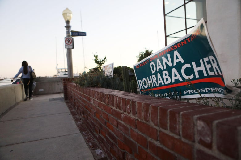 A Dana Rohrabacher campaign sign is posted in front of a home.