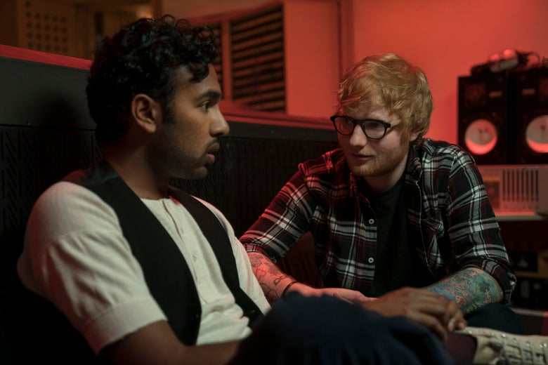 Hamish Patel and Ed Sheeran sit in a red-tinted room.