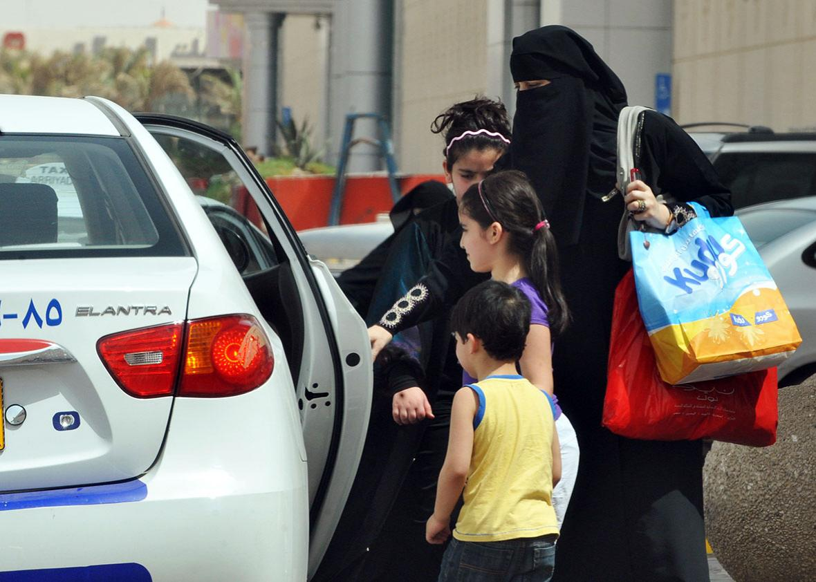 A Saudi woman and her children get into a taxi in Riyadh on June 14, 2011, three days before a June 17 nationwide campaign by Saudi women who are planning to take the wheel in protest against a driving ban which is unique to the kingdom that applies a strict version of Sunni Islam.