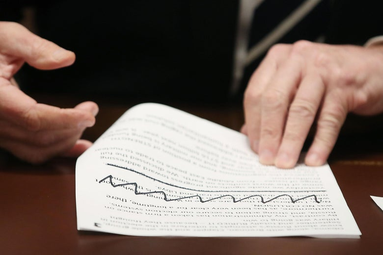 Trump's hands hold typed notes with Sharpie'd scribbles on them.