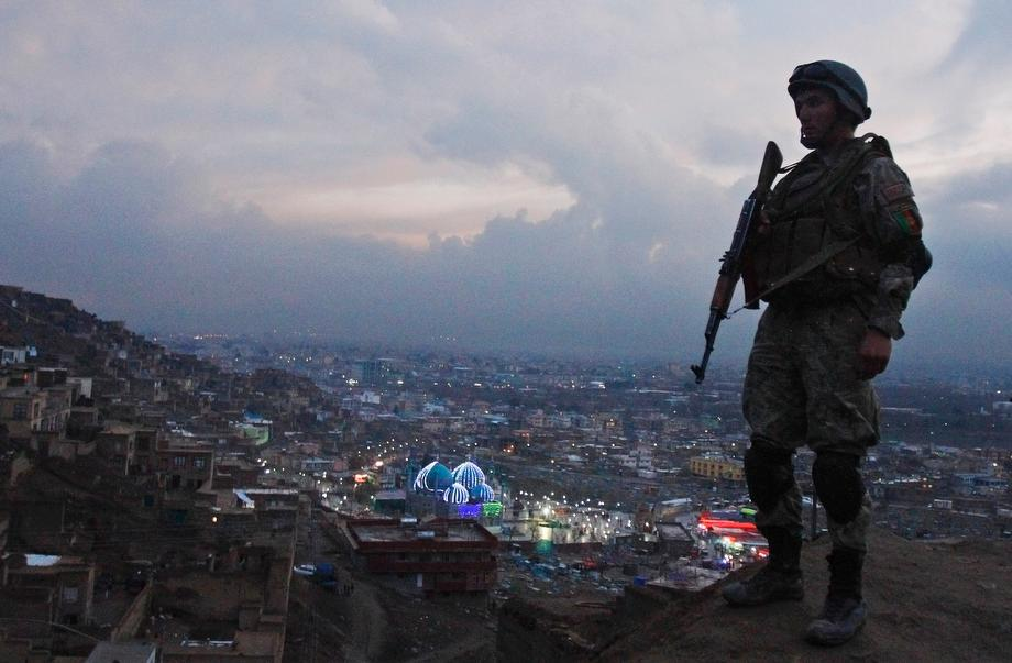 An Afghan Army soldier secures the hill overlooking the Kart-e Sakhi mosque in Kabul, Afghanistan on March 20, 2013. Thousands of Afghans will celebrated the Persian New Year Nowruz, marking the first day of spring and the beginning of the year on the Persian calendar.