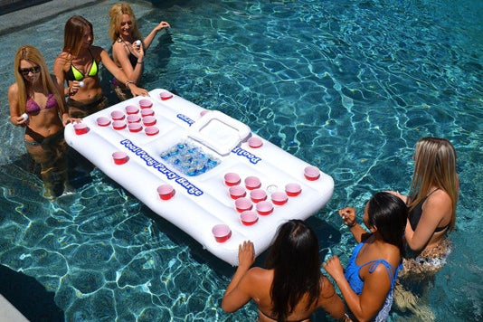 Players playing the GoPong Original Pool Party Barge Floating Beer Pong Table.