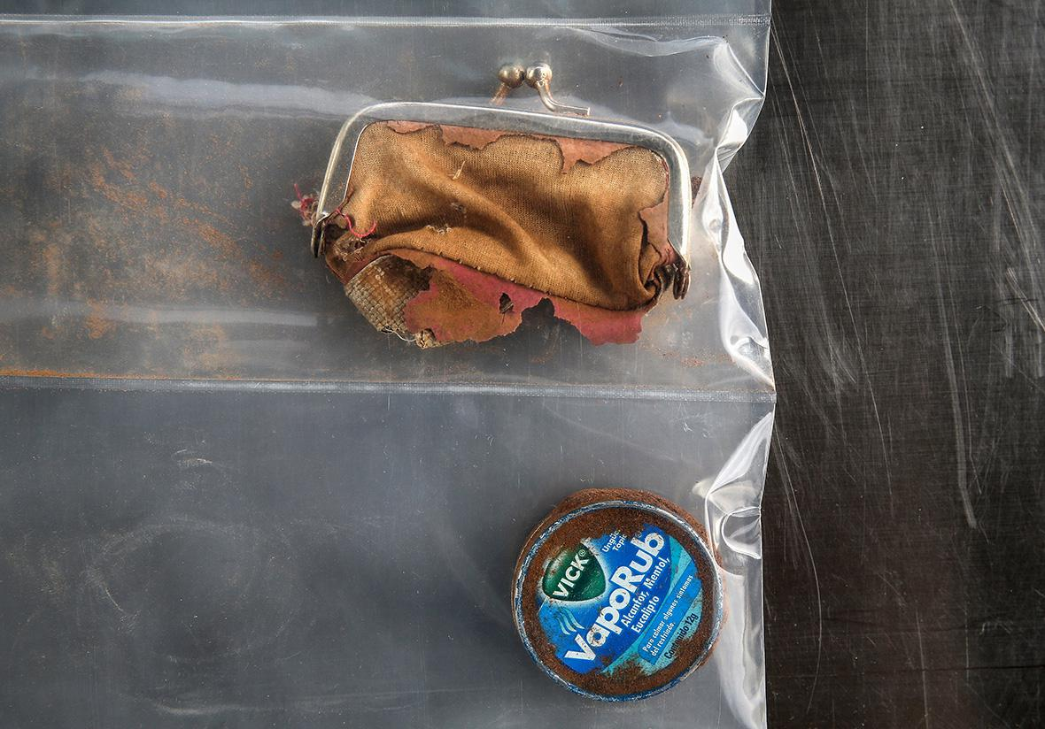A change purse and a Vic's Vapor Rub container found with the skeletal remains of a person discovered in the Arizona desert on Sept. 23, 2014.