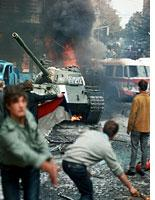 Residents of Prague try to stop a Soviet tank. Click image to expand.