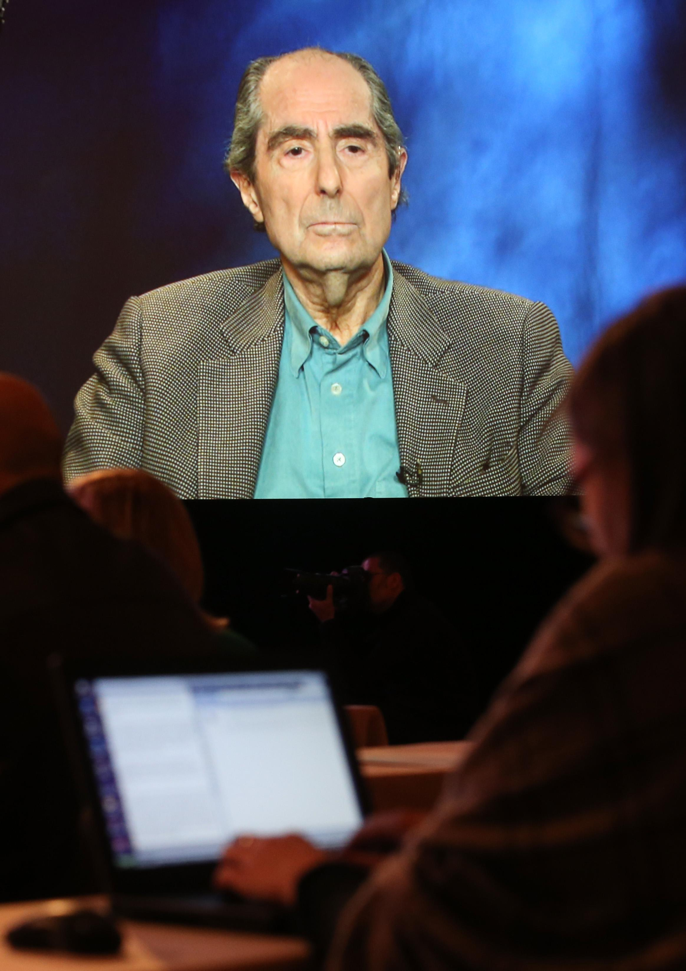Philip Roth is projected onscreen as he speaks via satellite video feed to the audience during the PBS panel of 'AMERICAN MASTERS Philip Roth: Unmasked' at the 2013 Winter Television Critics Association Press Tour at the Langham Huntington Hotel & Spa on January 14, 2013 in Pasadena, California.  (Photo by Frederick M. Brown/Getty Images)