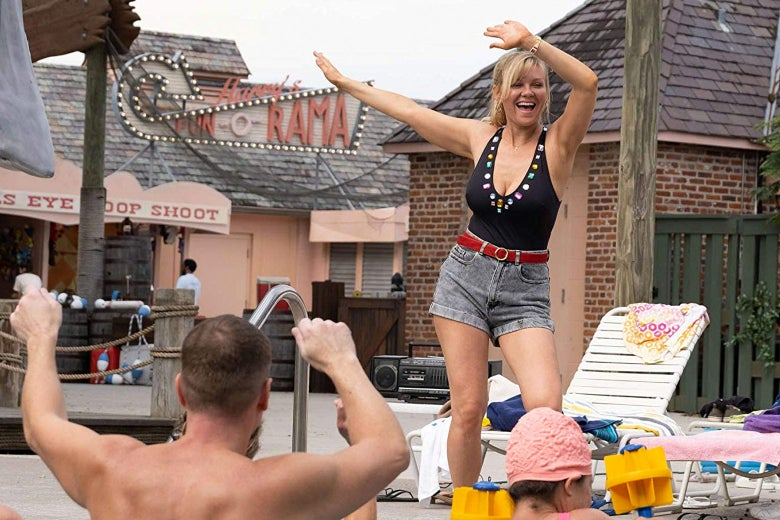 Kirsten Dunst, as Krystal Stubbs, dances by a pool at the water park in the show.