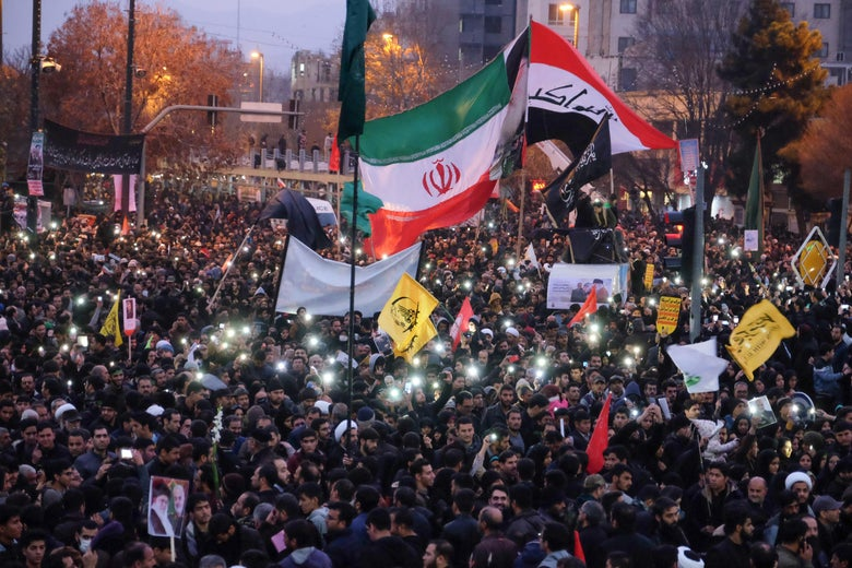Iranians gather in the northeastern city of Mashhad on January 5, 2020 to pay homage to top general Qasem Soleimani and others after they were killed in a US strike in Baghdad.