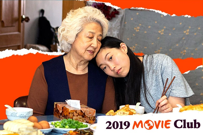 Awkwafina, as Billi, rests her head on the shoulder of Zhao, as Billi's grandmother, as they sit at a table covered in plates of food, in a scene from The Farewell.