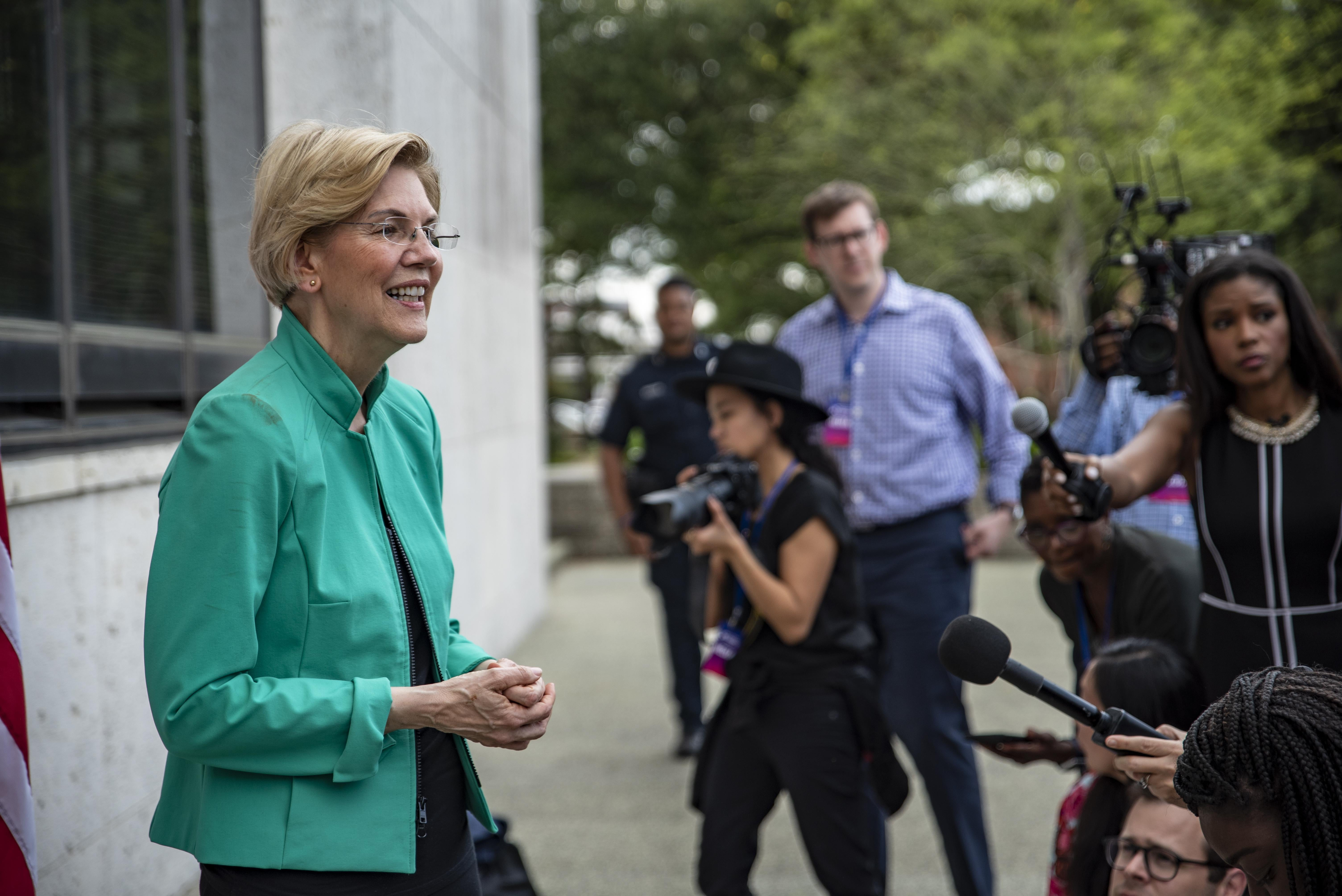 HOUSTON, TX - APRIL 24: Democratic presidential candidate Sen. Elizabeth Warren (D-MA) speaks to members of the media after the She The People Presidential Forum at Texas Southern University on April 24, 2019 in Houston, Texas. Many of the Democrat presidential candidates are attending the forum to focus on issues important to women of color. (Photo by Sergio Flores/Getty Images)