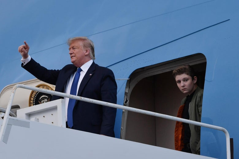 Donald and Barron Trump exit a plane at Palm Beach International Airport