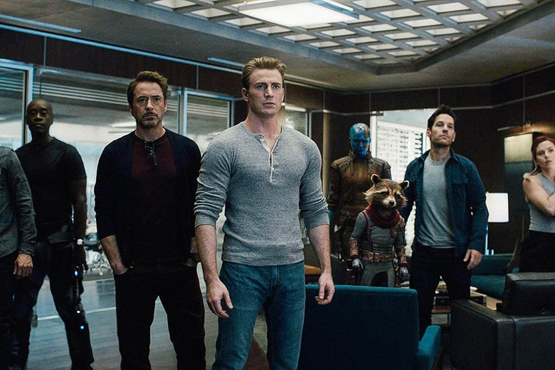 Don Cheadle as James Rhodes, Robert Downey Jr. as Tony Stark, Chris Evans as Steve Rogers, Karen Gillan as Nebula, Rocket Raccoon, Paul Rudd as Ant-Man, and Scarlett Johansson as Black Widow in a meeting room in a scene from Avengers: Endgame.